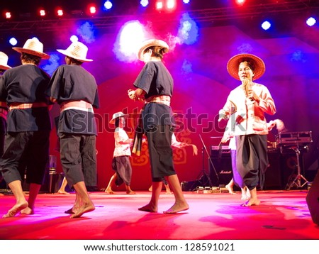 NAKHONSAWAN, THAILAND-FEBRUARY 4: People performing Rice Harvest Dance in Chinese New Year Festival on February 4, 2013 in Nakhonsawan.