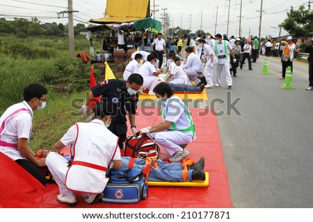 NAKHONSAWAN/THAILAND-JULY 31: Exercise Management for group accident on July 31, 2014 in Nakhonsawan. Rescue and Medical Personnel teams screen, treat, and transfer the accidental victims. - stock photo
