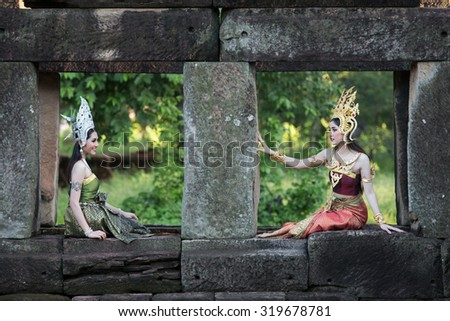 NAKORN RATCHASIMA - SEP 19: Unidentified woman with Thai dress at Phanomwan Historical Park on September 19, 2015 in Nakhon Ratchasima, Thailand