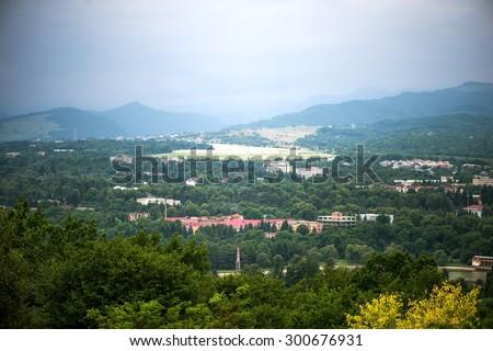NALCHIK, RUSSIA - July 03: Panoramic top view of the city Nalchik (capital of Kabardino-Balkarian Republic) from the mountain kizilovka in July 03, 2015 in Nalchik. - stock photo