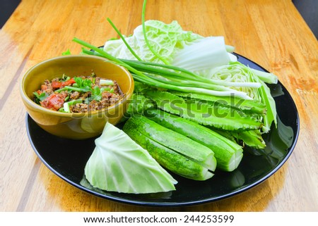 Nam prik ong, Thai northern style chilli paste (meat and tomato spicy dip) and vegetable thai food - stock photo