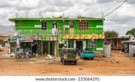 NAMANGA, KENYA - OCTOBER 20, 2014 : Shopping street in Namanga. Namanga is a town lying on the border between Kenya and Tanzania in Kajiado District, Rift Valley Province. - stock photo