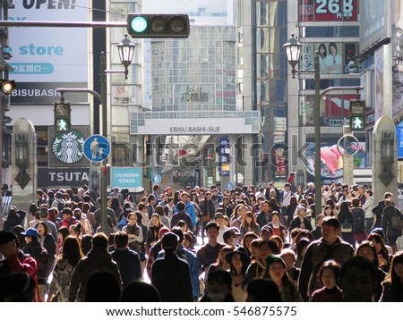 NAMBA, OSAKA, JAPAN - NOVEMBER 30 : People walking on shopping street in Namba district, taken on November 30, 2014 in Osaka. Namba is the popular entertainment and tourist spot in Osaka.