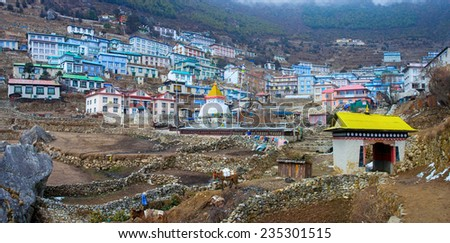 NAMCHE BAZAR,NEPAL-MARCH 5: View on  Namche Bazar and buddist stupa  on March 5, 2014  Khumbu district, Himalayas, Nepal  - stock photo