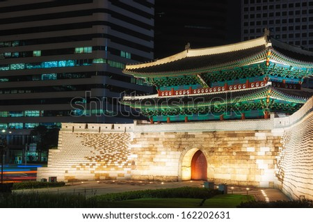 Namdaemun Gate is one of the Eight Gates of the fortress wall that surrounded the city during the Joseon Dynasty. It was damaged by arson in 2008; restoration completed in 2013. - stock photo