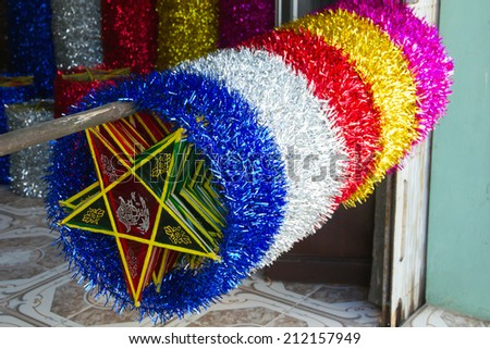 NAMDINH - AUGUST 17, 2014: The star lanterns in Namdinh - Vietnam. The star-shaped lanterns, a specific kind of toys for Mid Autumn Festival in Vietnam.