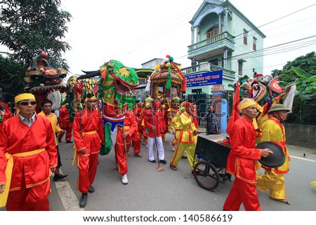 "NAMDINH, VIETNAM - APRIL 14: A group of unidentified people marched in an annual traditional festival at April 14, 2013 in Nam Dinh, Vietnam. The official name of this event is ""PHU DAY "" festival"