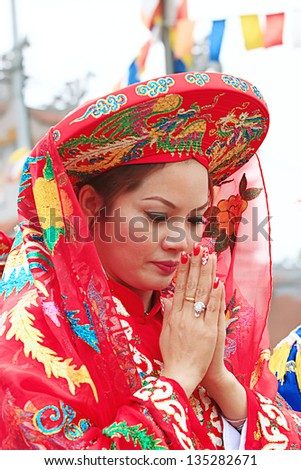 NAMDINH, VIETNAM - APRIL 14: An unidentified woman wearing traditional dress prepare for performances at Phu Giay festival on April 14, 2013 in Nam Dinh, Vietnam