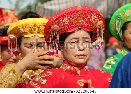 NAMDINH, VIETNAM - May 03, 2015: The unidentified woman and men in traditional festivals in Namdinh, Vietnam - stock photo