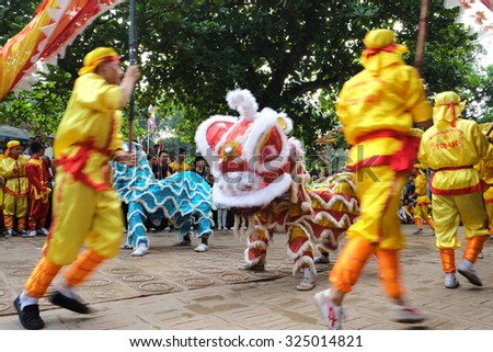 NAMDINH, VIETNAM - OCTOBER 2, 2015: Vietnam dancer with colorful dragon in Tran temple festival, Namdinh, vietnam. The folklore activities to commemorate the national hero Tran Hung Dao.