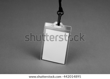 Name id card badge with cord on gray background