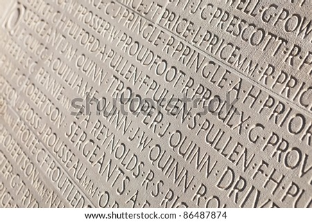 Names of soldiers engraved in white marble tombstone at Vimy War Canadian memorial. - stock photo