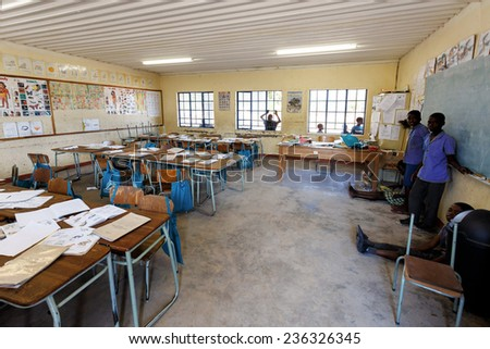 NAMIBIA, KAVANGO, OCTOBER 15: Happy Namibian school children waiting for a lesson. Kavango was the region with the highest poverty level in Namibia. October 15, 2014, Namibia - stock photo