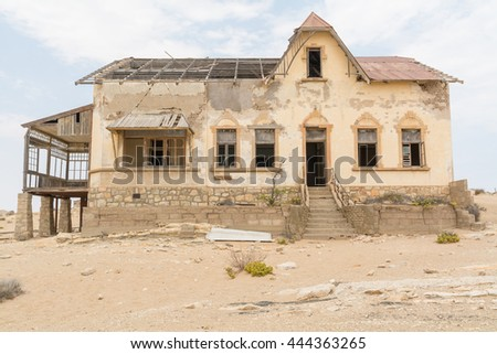 NAMIBIA, KOLMANSKOP - SEPTEMBER, 14. 2014: Ghost Town Kolmanskop, former Diamond Dagger Town in desert stripe near Luederitz. It was used from 1908 till 1930. Now it's abandoned and desertificated.