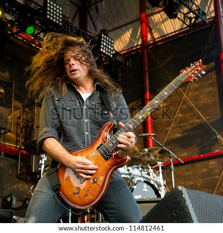 NAMPA, IDAHO - SEPTEMBER 25: Mike Mushok from Stained jams out on his guitar during the Rockstar Uproar Festival on September 25 2012 in Nampa, Idaho. - stock photo