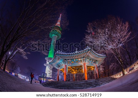 Namsan Park And N Seoul Tower At Night cover by snow, South Korea.