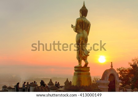Nan,Thailand - December 21,2014 : behind of golden buddha statue in sunrise time