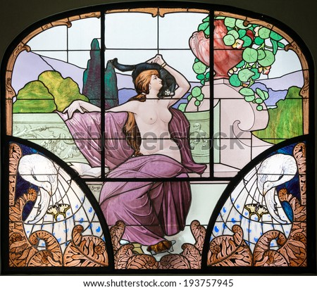 NANCY, FRANCE - MAY 10, 2014: Art Nouveau stained glass window made by Henri Berge (1870 -1937) in the museum of Nancy School. Nancy is one of the capitals of Art Nouveau.  - stock photo