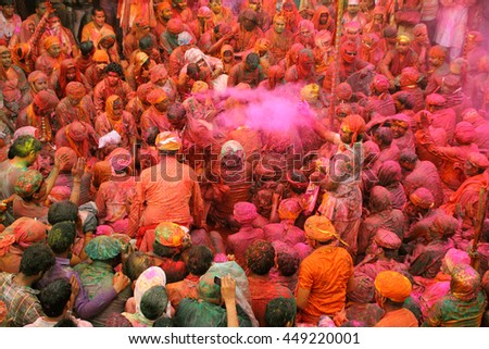 NANDGAON - MAR 22: Unidentified people throw colors to each other during the Holi celebration on March 22, 2013 in Nandgaon, Uttar Pradesh,India. Holi is the most celebrated festival in India.