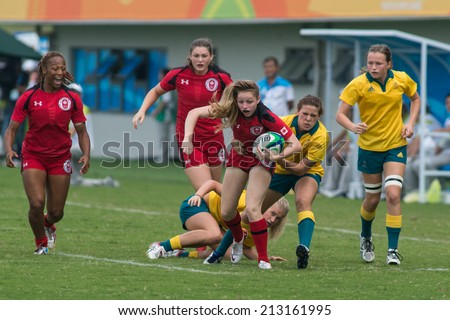 NANJING, CHINA-AUGUST 20: Australia Rugby Team (yellow) plays against Canada Rugby Team (red) during final match of 2014 Youth Olympic Games on August 20, 2014 in Nanjing, China. Australia wins 38-10.