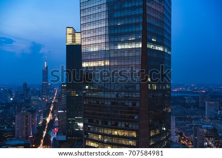 Nanjing, China - August 2017 - Nanjing Sunset, it is in blue time, the huge building is Nanjing Center.
