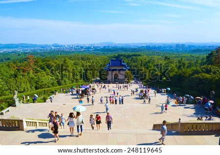 NANJING, CHINA, AUGUST 29, 2013: People are climbing in the steep stairway to the sun yat sen memorial in chinese nanjing. - stock photo