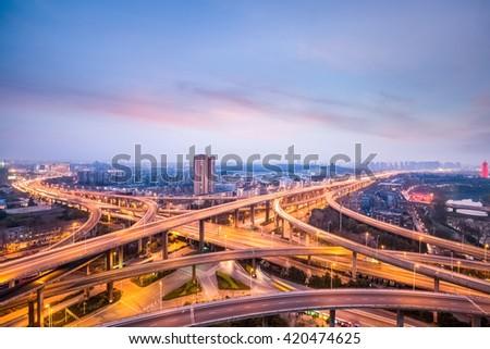 nanjing city interchange in nightfall, road junction of urban expressway background, China - stock photo