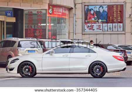 NANJING-MAY 25, 2014. Mercedes-Benz CLS 63 AMG. AMG is the official Mercedes-Benz house tuner which offers a full palette of high performance cars, based on the Mercedes-Benz standard models  - stock photo
