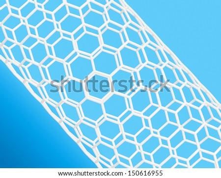 Nanotube structure on blue background  - stock photo