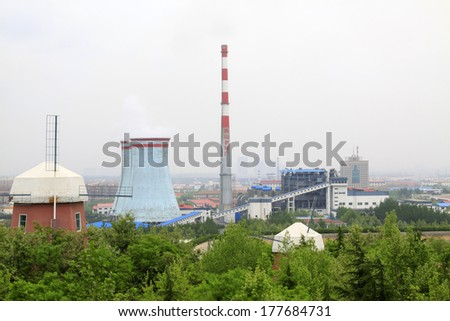 NANSHAN MAY 17: ?Nanshan thermal power plant building scenery in the shade of trees on May 17, 2013, Longkou City, Shandong Province, China