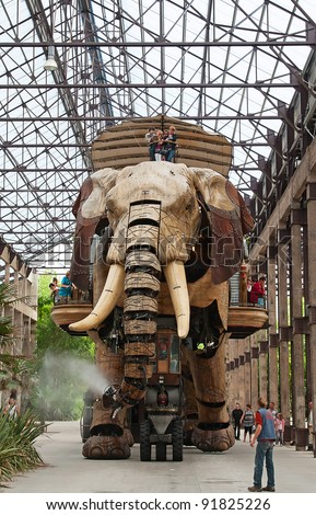 "NANTES - AUGUST 09: The Great Elephant of Nantes on August 09, 2009 in Nantes, France. The 12-metre high gigantic mechanical animal is main attraction of steampunk park ""Les Machines de l'Ile"". - stock photo"