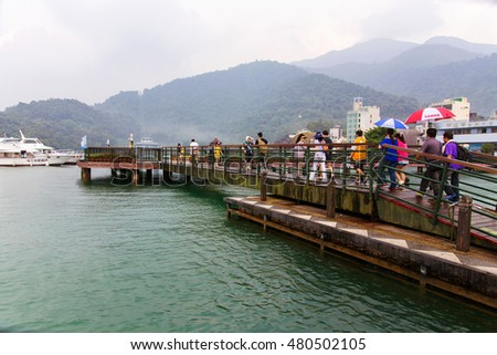 NANTOU, TAIWAN - September 04: Tourists walking on a bridge in the main tourist area of Sun moon lake on September 04th, 2014 in Nantou