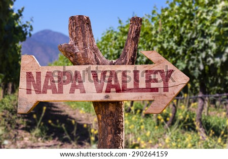 Napa Valley wooden sign with winery background - stock photo