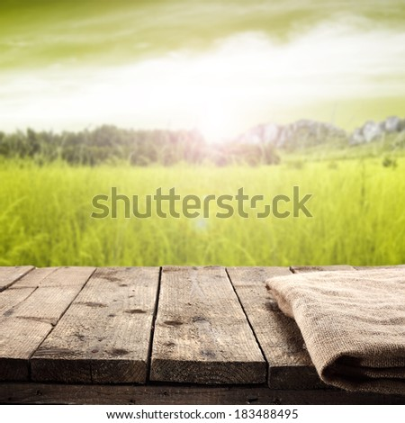 napkin and sunset with landscape  - stock photo