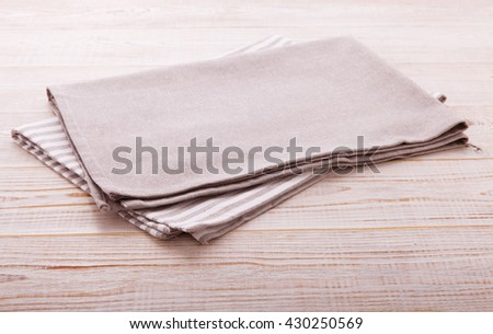 Napkin. Cloth napkin in perspective on white wooden background.Top view, mock up. - stock photo