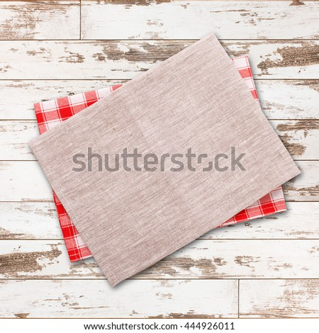 Napkin. Cloth napkin on white wooden background. Napkin top view, mock up. Wooden table top view square. - stock photo