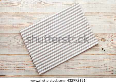 Napkin. Cloth napkin on white wooden background. Top view, mock up. - stock photo