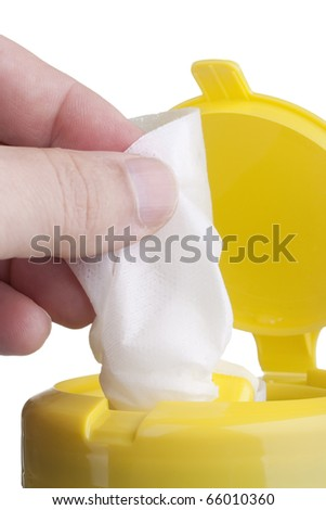 Napkin for cleaning in a plastic container with a white background. - stock photo