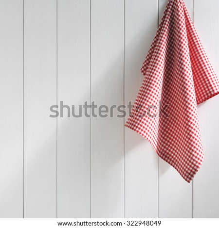 napkin hanging on white wall - stock photo