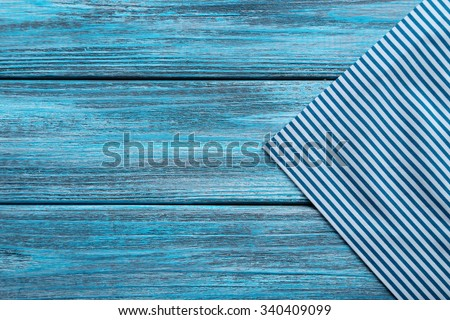 Napkin on blue wooden table, close up - stock photo