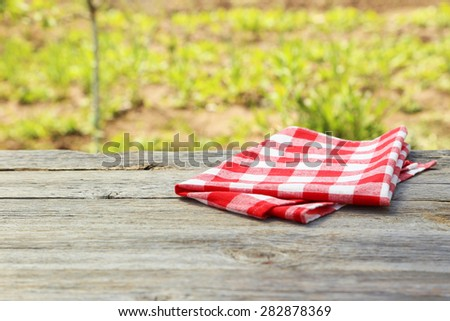 Napkin on brown wooden background - stock photo