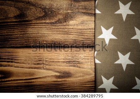 Napkin on old wooden burned table or board for background. Toned.