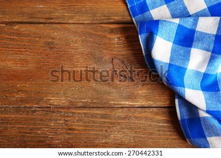 Napkin on wooden background - stock photo