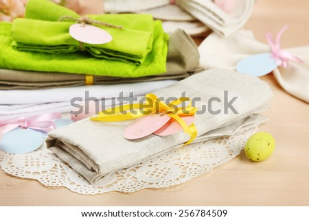 Napkin with Easter decorations  on color wooden background