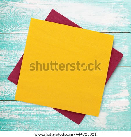 Napkins. Paper napkins on old wooden table. Colorful napkins top view mock up for design.