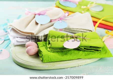 Napkins with Easter decorations  on color wooden background