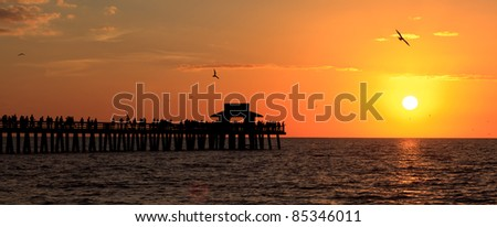 Naples fishing pier at sunset in Florida. - stock photo