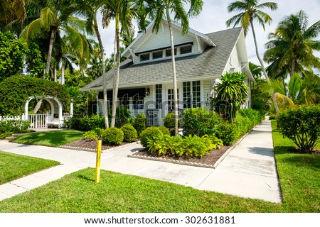 Naples, Florida USA - July 28, 2015: Typical vintage wood frame architecture style home in the coastal residential historic district of Naples. - stock photo