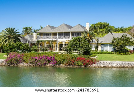 NAPLES, FLORIDA USA - May 8 2013: Waterfront  house with colourful gardens on the bayside area of Naples. Naples is one of the wealthiest cities in the United States - stock photo