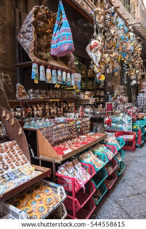 Naples, Italy - August 30, 2016: Traditional souvenir stall on the narrow street of Naples.